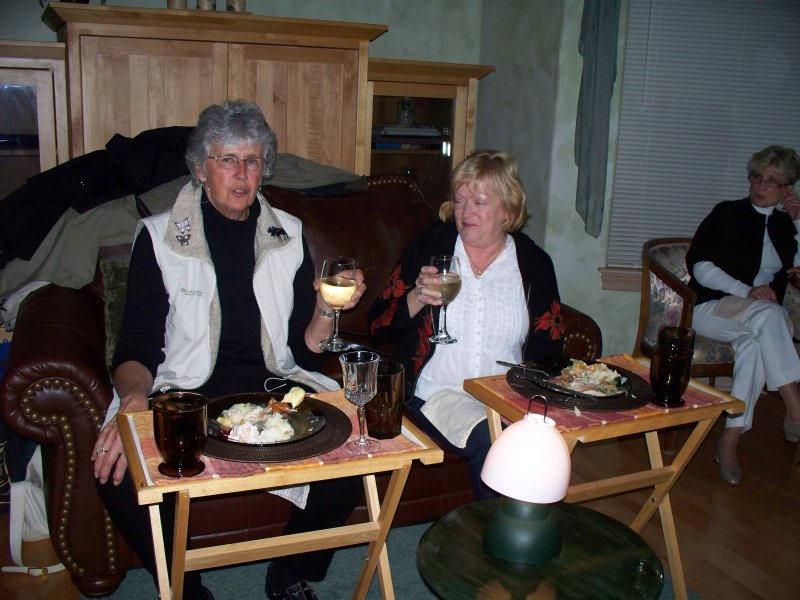 Darlene and Jeannie share a glass and a lantern