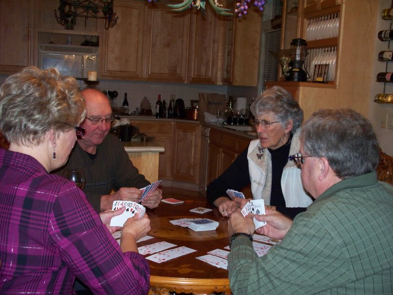 Chuck and Bud winning a game of Hand and Foot. Darlene and Cassandra look very serious